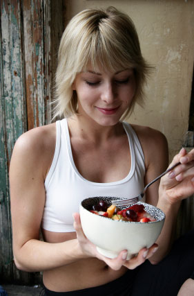 Lady eating healthy high fiber foods.
